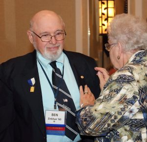 Joyce Zinkan pins her husband Ben with his new Ad Astra pin.  It was tradition for mothers to pin their sons at the conclusion of a school year.